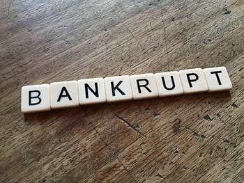 bankrupt spelled out on table by bankruptcy solicitors Sunshine Coast