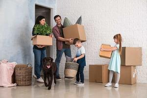 family holding boxes in empty house after applying for transfer duty concessions